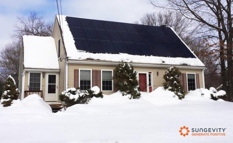 a snowy solar home